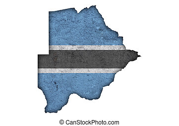 Map and flag of Botswana on weathered concrete