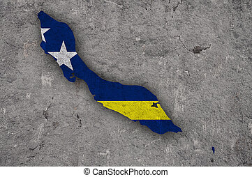 Map and flag of Curacao on weathered concrete