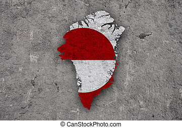 Map and flag of Greenland on weathered concrete