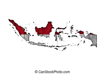 Map and flag of Indonesia on weathered wood