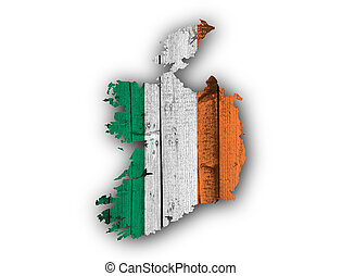 Map and flag of Ireland on weathered wood