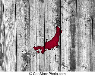 Map and flag of Japan on weathered wood