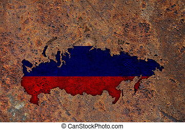 Map and flag of Russia on rusty metal