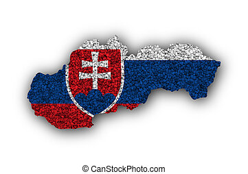 Map and flag of Slovakia on poppy seeds