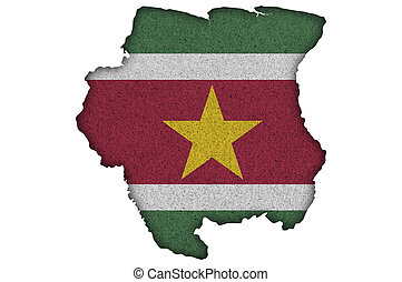 Map and flag of Suriname on felt