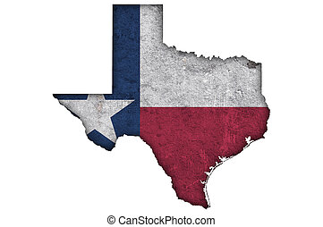 Map and flag of Texas on weathered concrete