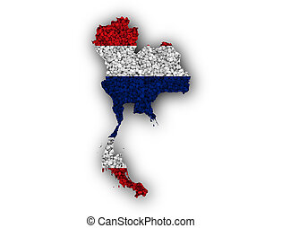 Map and flag of Thailand on poppy seeds
