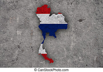 Map and flag of Thailand on weathered concrete