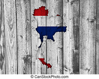 Map and flag of Thailand on weathered wood