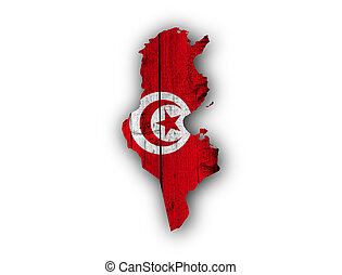 Map and flag of Tunisia on weathered wood