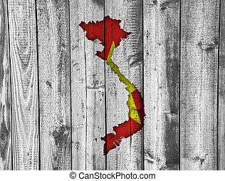 Map and flag of Vietnam on weathered wood