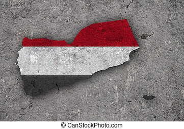 Map and flag of Yemen on weathered concrete