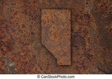 Map of Alberta on rusty metal