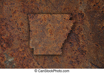 Map of Arkansas on rusty metal