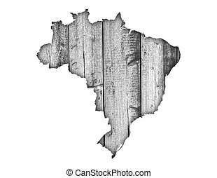 Map of Brazil on weathered wood