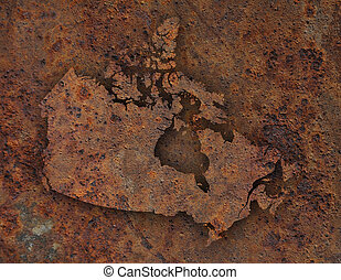 Map of Canada on rusty metal