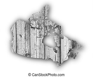 Map of Canada on weathered wood