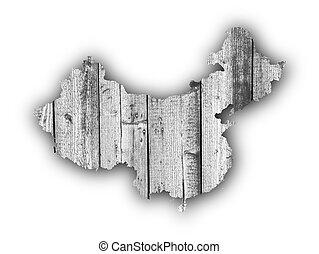 Map of China on weathered wood