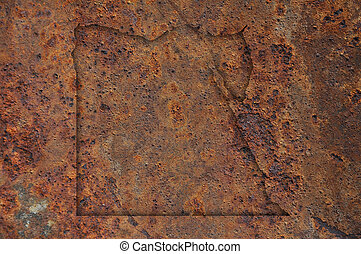 Map of Egypt on rusty metal