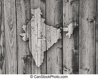 Map of India on weathered wood
