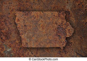 Map of Iowa on rusty metal