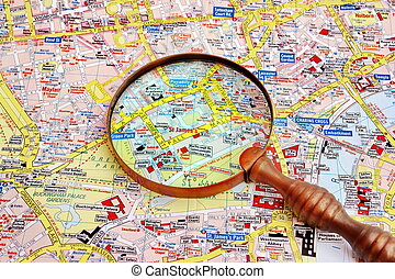 Map of London and magnifier glass. Piccadilly and Pall Mall...
