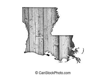 Map of Louisiana on weathered wood