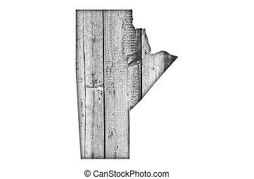 Map of Manitoba on weathered wood