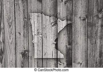 Map of Minnesota on weathered wood