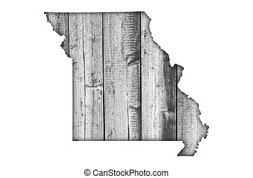 Map of Missouri on weathered wood