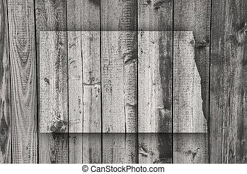 Map of North Dakota on weathered wood