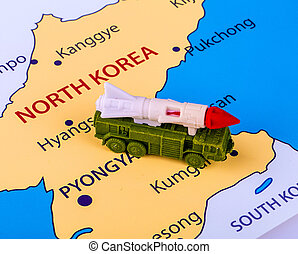 Map of North Korea with a military machine