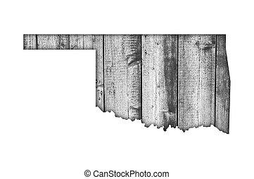 Map of Oklahoma on weathered wood