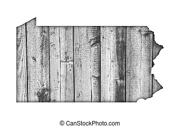 Map of Pennsylvania on weathered wood