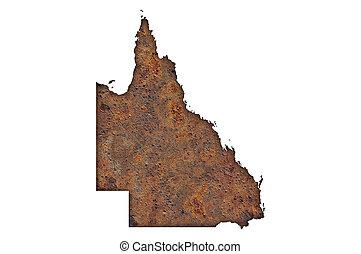 Map of Queensland on rusty metal