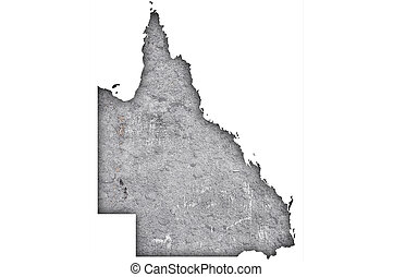 Map of Queensland on weathered concrete