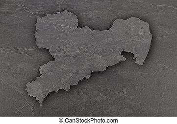 Map of Saxony on dark slate