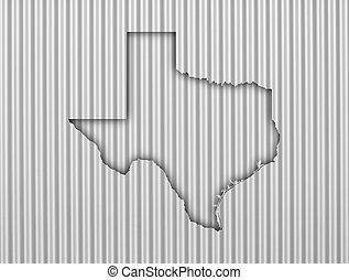 Map of Texas on corrugated iron