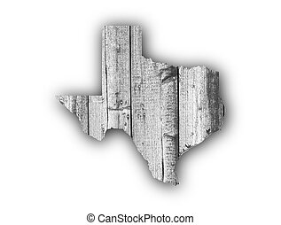 Map of Texas on weathered wood