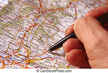 map with hand and pen; planning route