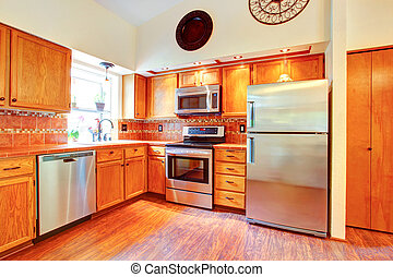 Maple cabinets and steel appliances - Kitchen room with...