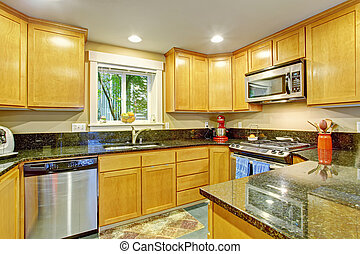 Maple kitchen cabinet with black granite tops - Kitchen...
