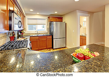 Maple kitchen cabinets with granite tops