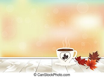 Maple leaves and coffee cup on wooden texture in autumn color background