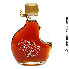 Maple Syrup - A small bottle of maple syrup with the maple ...