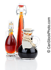 maple syrup in glass bottle or herbal syrup, ardent drink, mixture, with heart label. on white background.