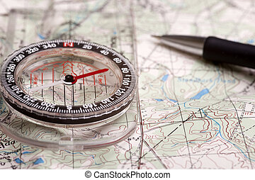 Mapping the way - A compass alongside a road on a map with a...