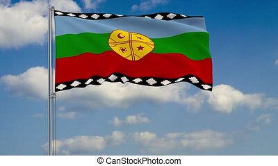 Mapuche flag against background of clouds floating on the blue sky