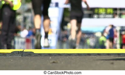 Marathon, finish line, camera blurred, shallow depth of...