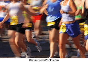 Marathon (in camera motion blur) - Runners streak past the ...